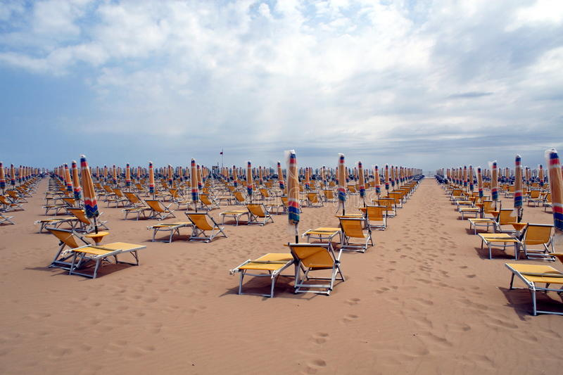Download Chairs, Beach Chairs And Umbrellas Closed Stock Image - Image: 23584363