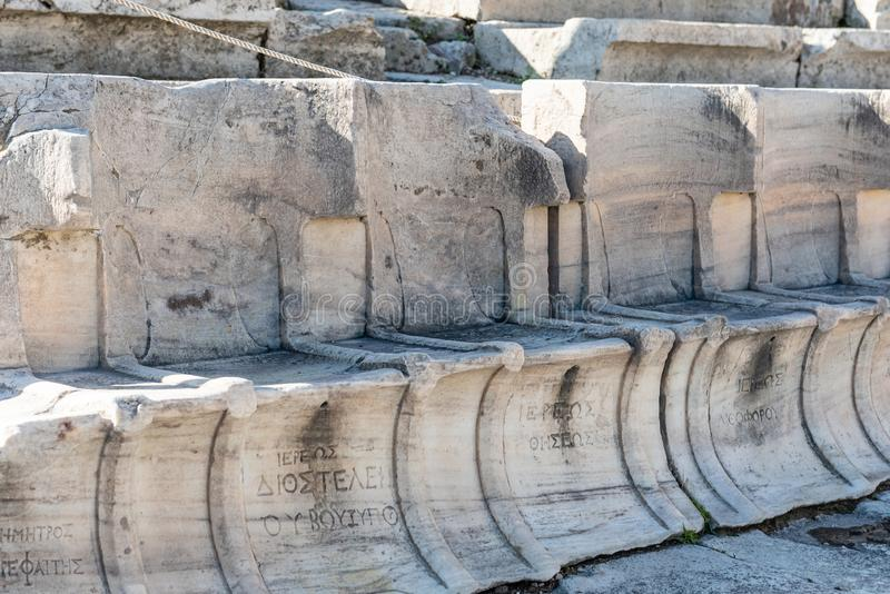Chairs carved in stone of the Theater of Dionysos Acropolis Athens stock photos