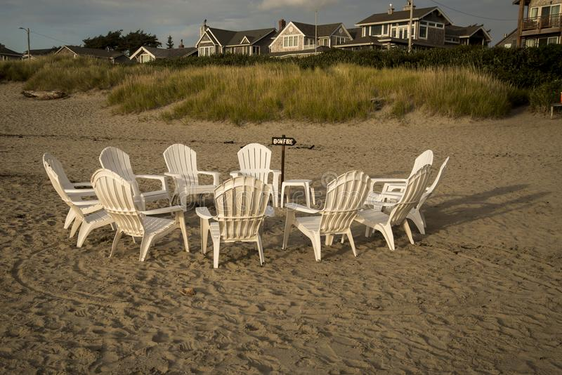 Chairs in a circle on the beach stock photos