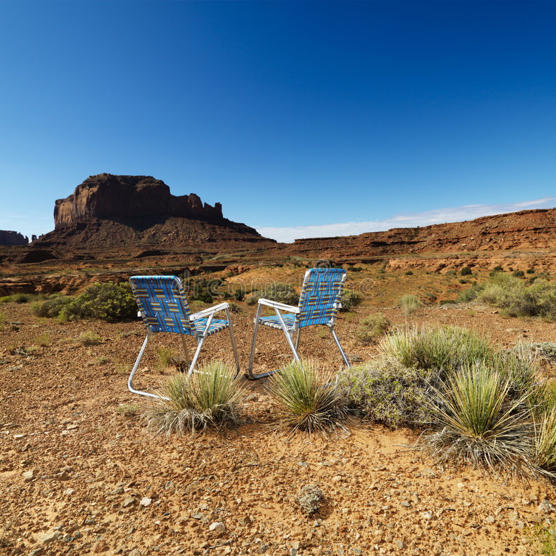 Chairs in desert. royalty free stock photo