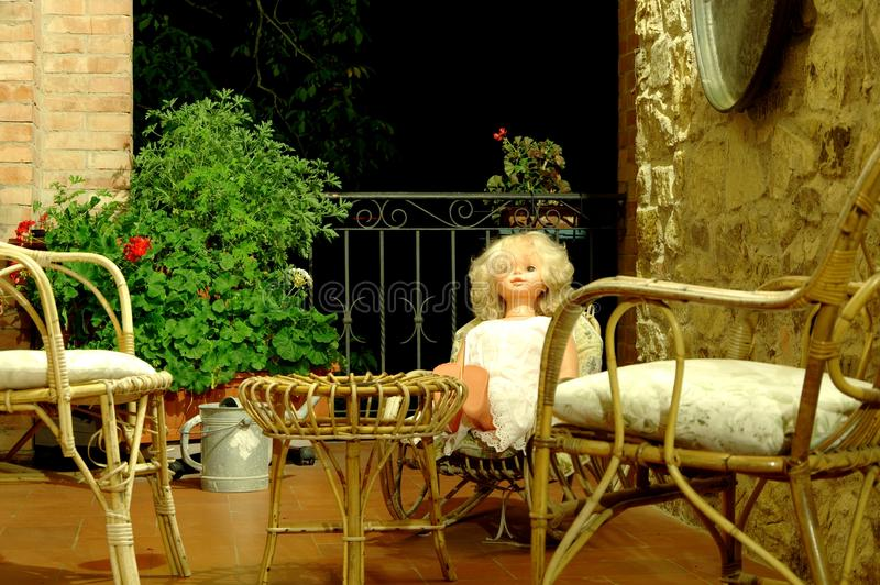 Chairs and doll on the balcony 4 stock image