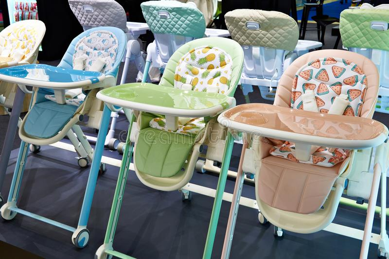 Chairs for feeding baby. In shop stock image