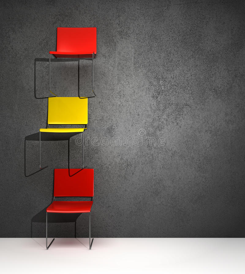Chairs hanging on the wall in a conceptual way royalty free stock photography