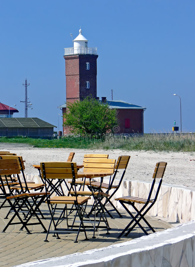 Chairs and lighthouse royalty free stock image