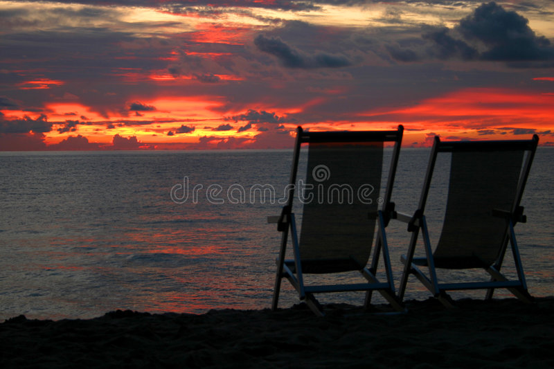 Download Chairs Looking Out On Beach Sunset Stock Photo - Image: 225982