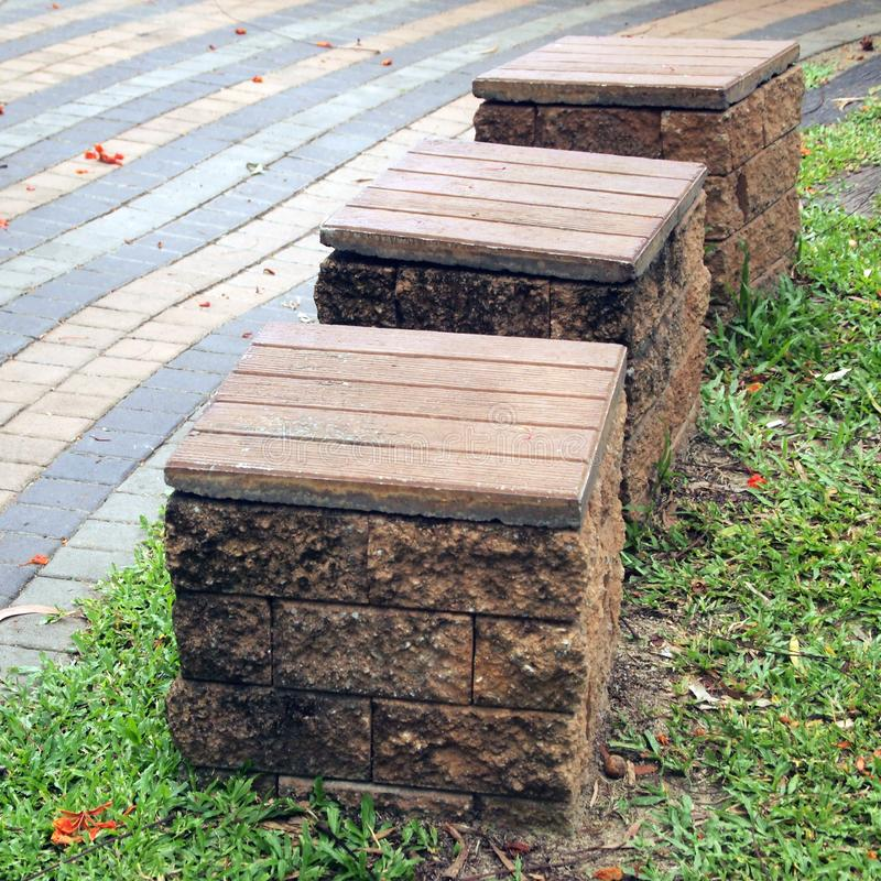 Chairs made ​​of bricks in the park royalty free stock photos