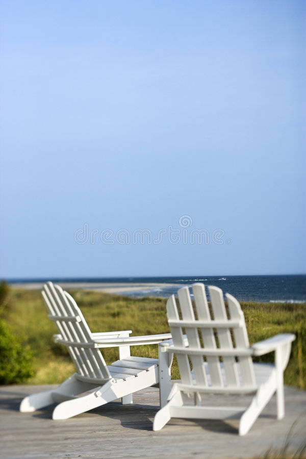 Chairs overlooking ocean royalty free stock image