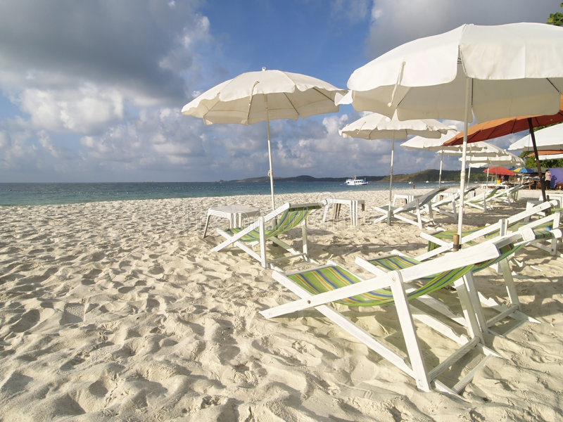 Chairs and parasols on the bea. Chairs and parasols on a white sand beach at Koh Samet in Rayong province, Thailand stock image