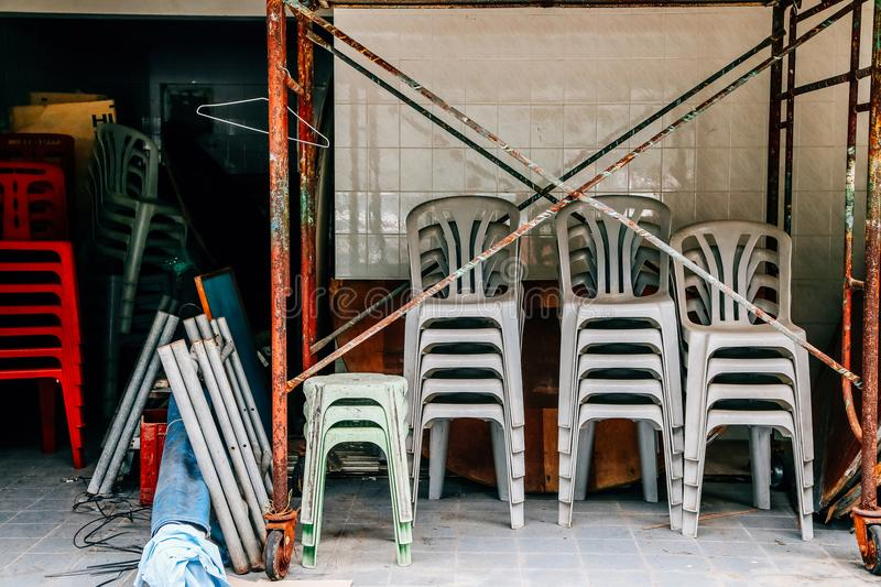 Chairs piled up in remodeling construction store at Lamma island village in HongKong royalty free stock photography