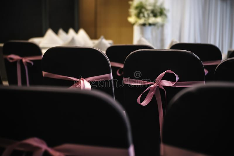 Wedding chairs with pink ribbon royalty free stock photo