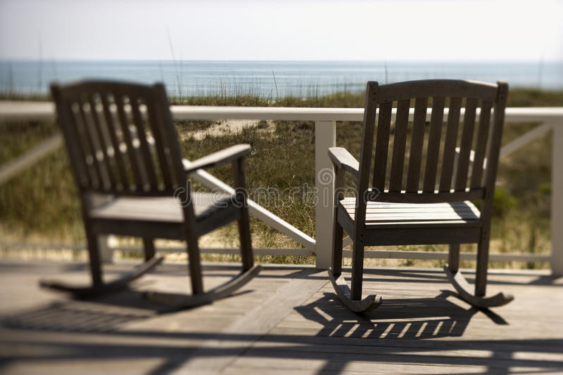 Chairs on Porch Facing Beach stock image