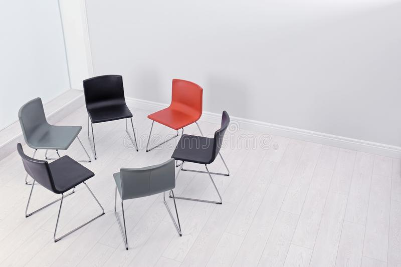 Chairs prepared for group therapy session in office, space for text. stock photos