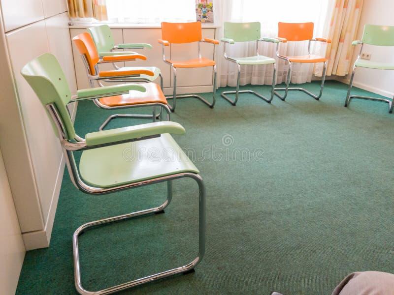 Download Chairs in room stock photo. Image of floor, green, orange - 110450042