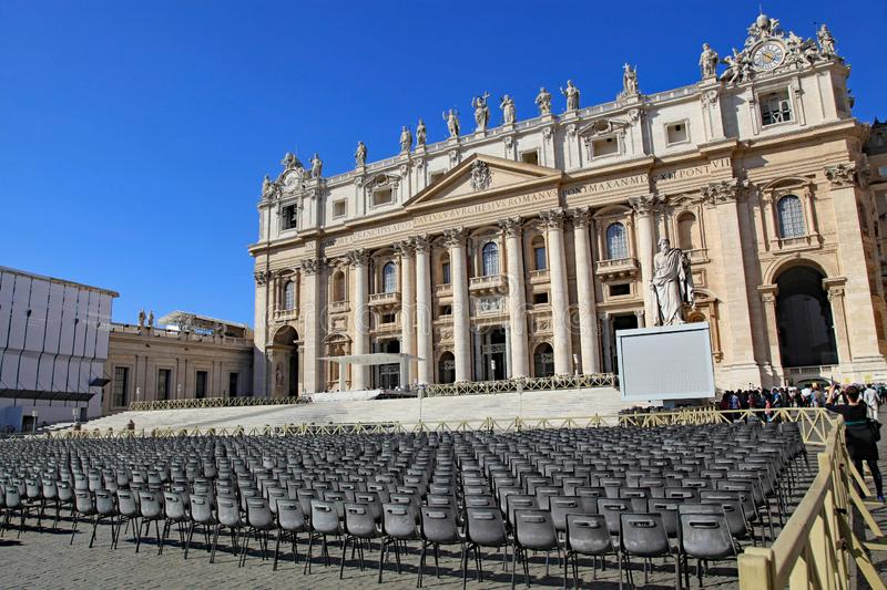 Chairs set up for a papal audience in front of St. Peter`s Basilica, Vatican City. Empty chairs set up for a papal audience in front of St. Peter`s Basilica royalty free stock photos