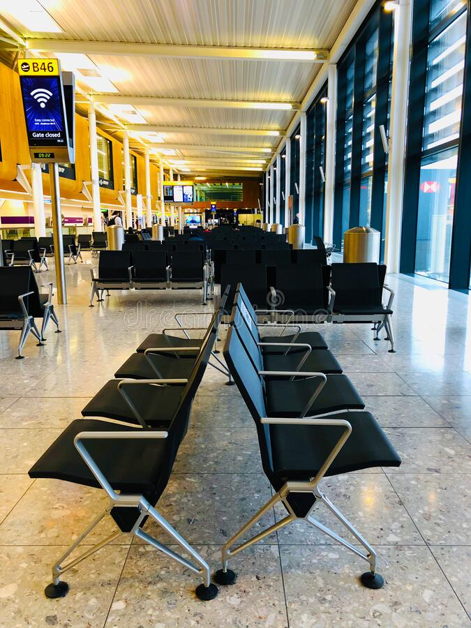 Interior of London Heathrow Airport. Chairs for sitting at London Heathrow Airport stock photo