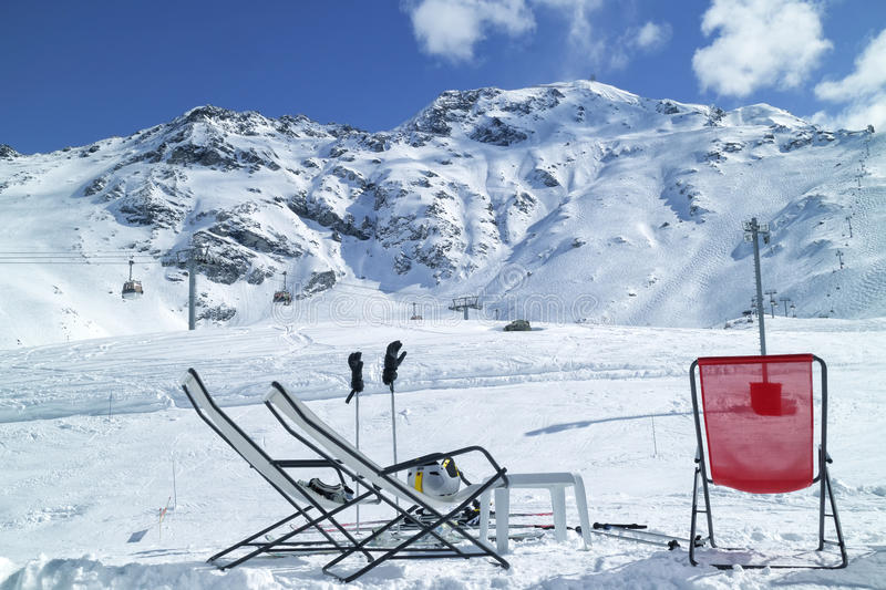 Chairs and skis in snowy French Alps mountains stock photo