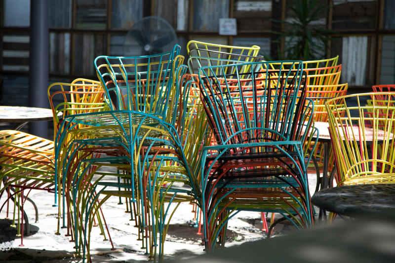 Chairs stacked at outdoor restaurant stock image
