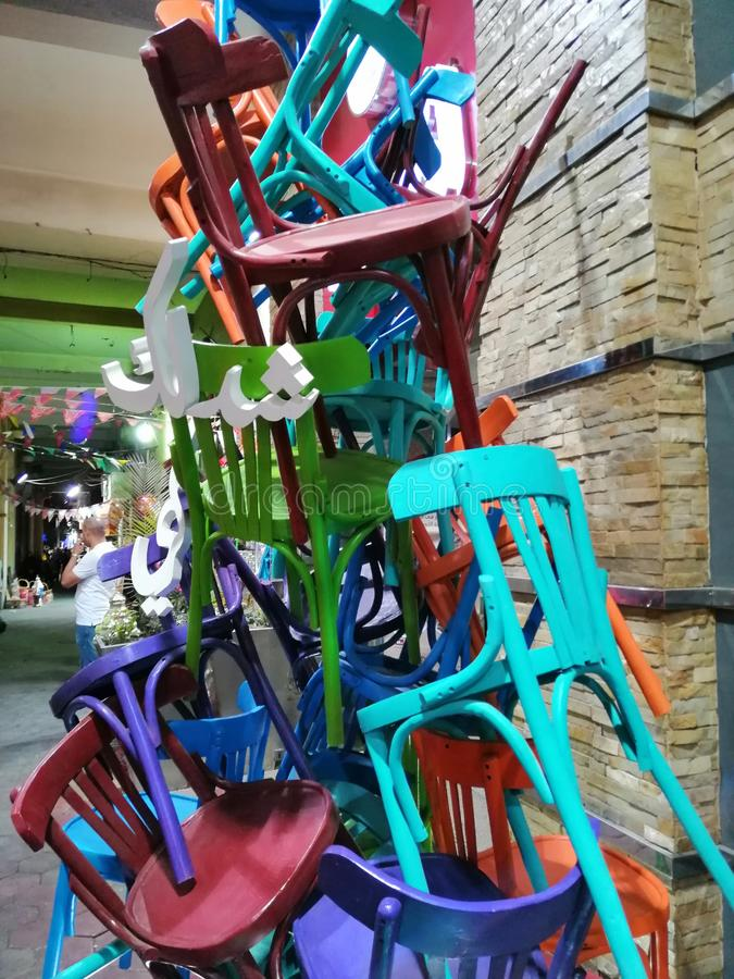 Chairs standing on each other. Ramadan& x27;s days circumference in Egypt in April 2015 stock photography