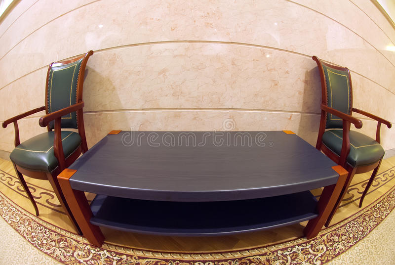 Chairs and table in hall stock photos