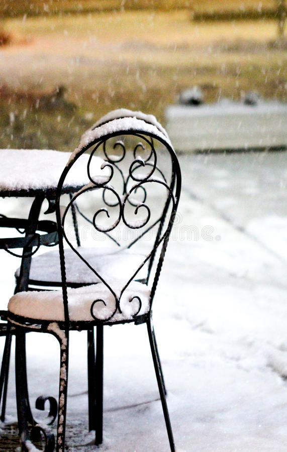 Download Chairs And Table In Outdoors Caffe On Snowy Cold Night Stock Photo - Image: 83700716