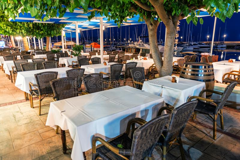 Chairs and tables in the restaurant royalty free stock photo