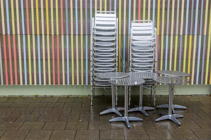 Chairs and tables on the rain stock images