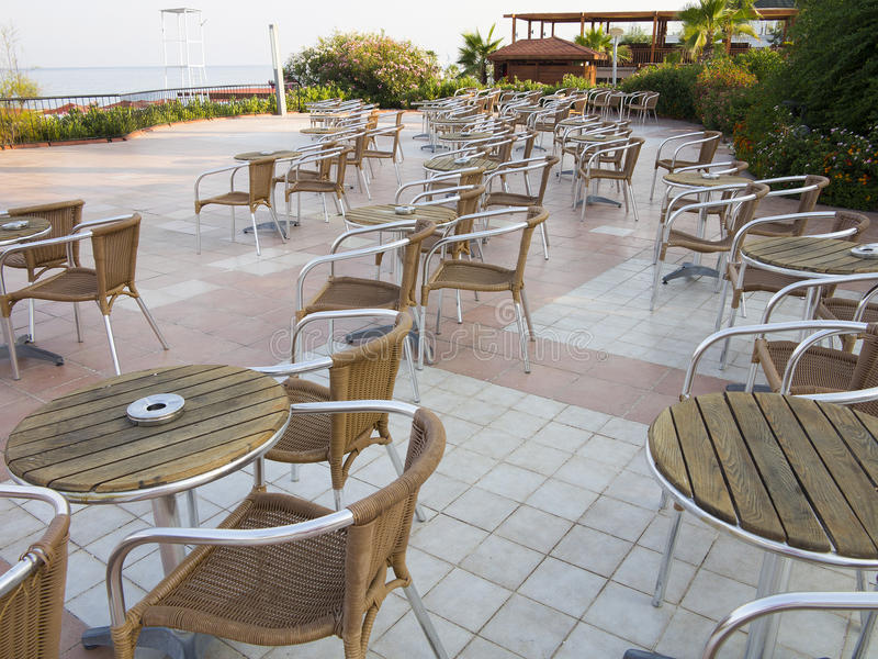 Chairs and tables on summer outdoor terrace cafe royalty free stock images
