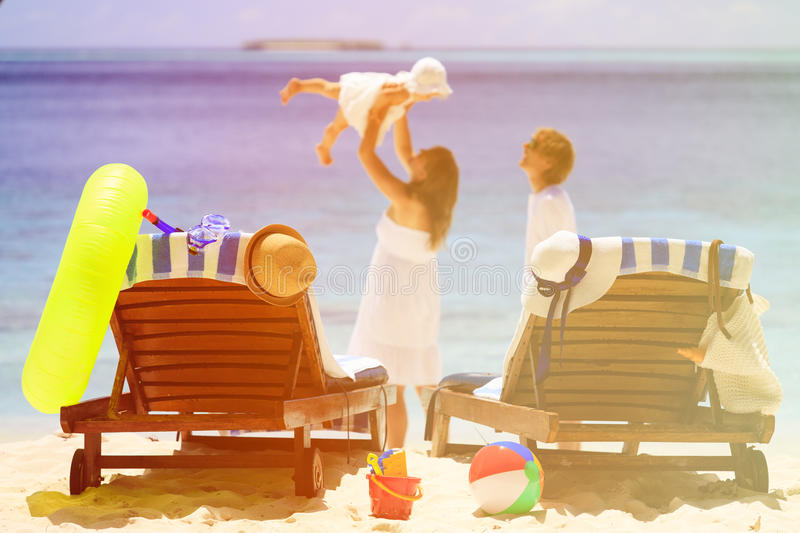 Chairs on tropical beach, family vacation concept royalty free stock images