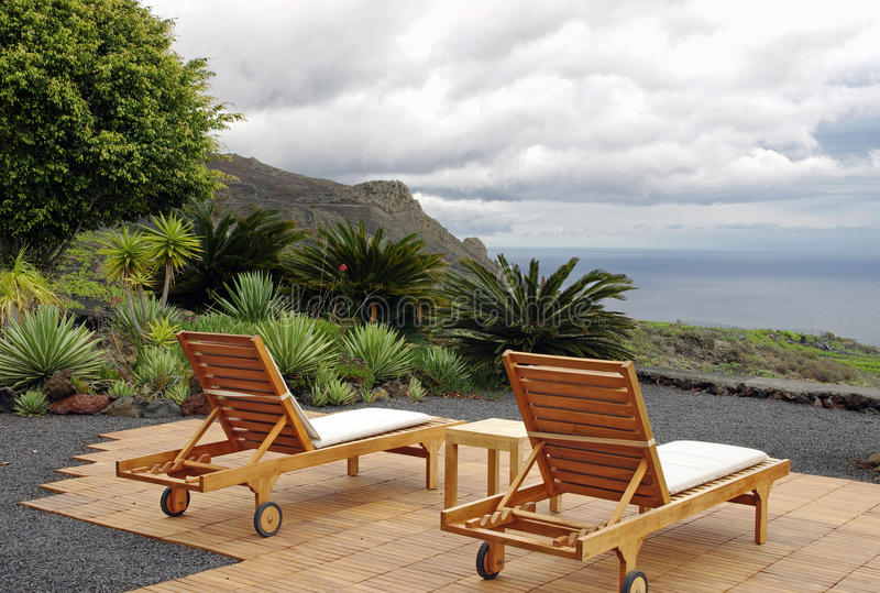 Download Chairs With The Volcano And Ocean Views Stock Photo - Image: 24719564