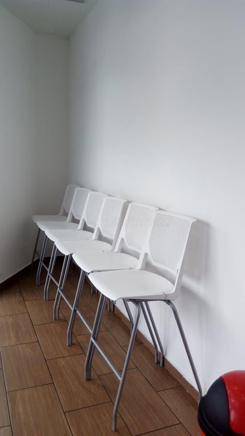 chairs white royaltyfria bilder