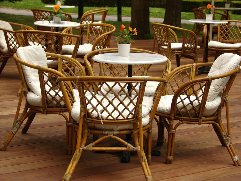Chairs from wicker. The photography of tables and chairs in the coffe garden stock photography