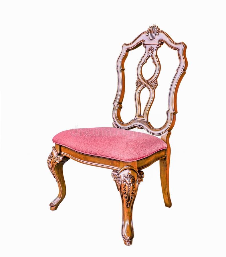 Chaise antique avec le coussin d'isolement avec le chemin de coupure photo stock