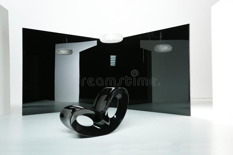 Chaise de basculage noire photographie stock