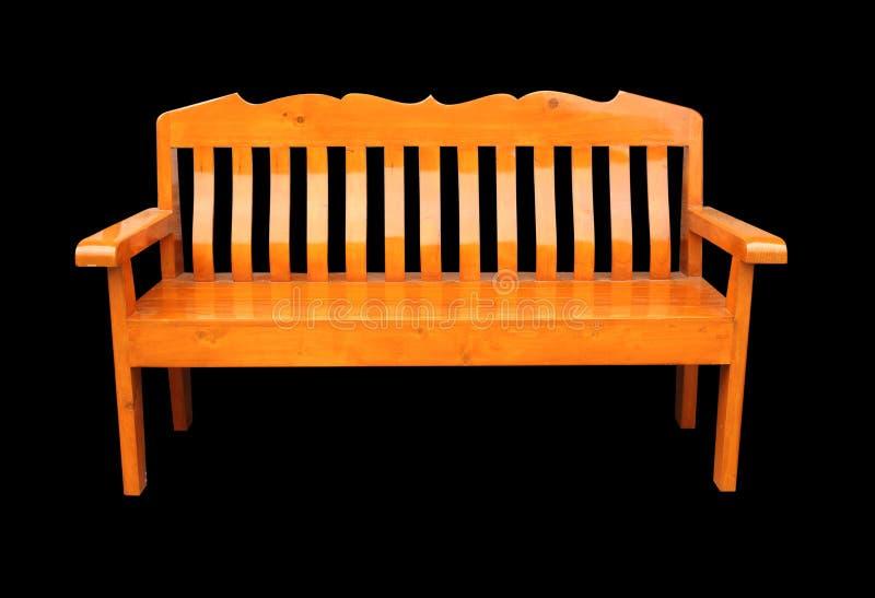 Chaise de Teakwood d'isolement à l'arrière-plan noir images stock
