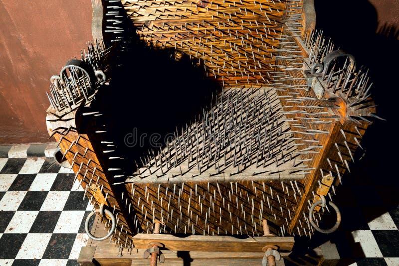 Chaise de torture photos stock