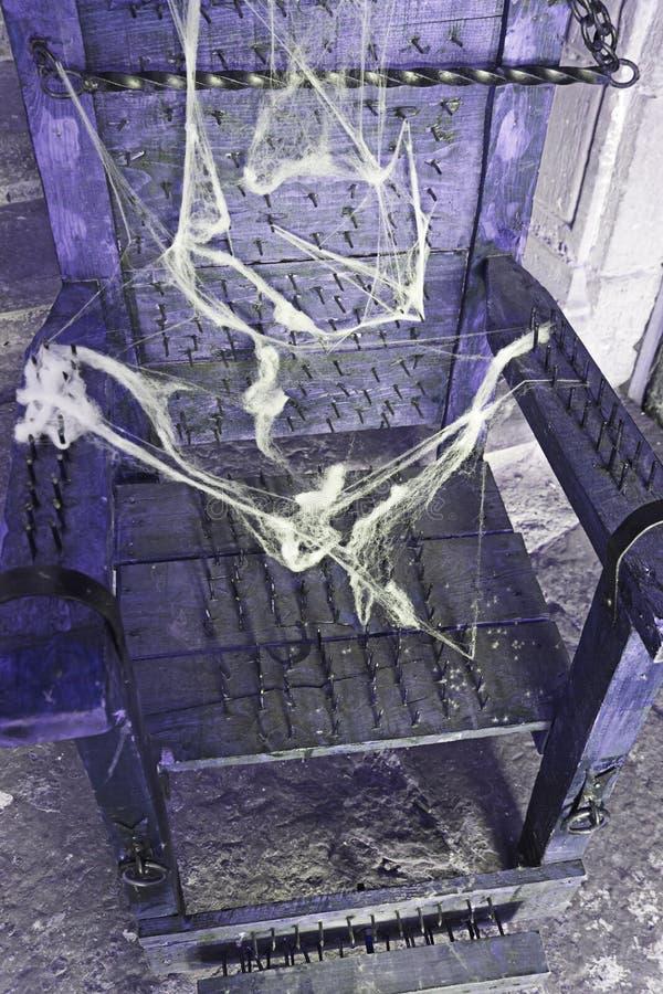Chaise de torture photographie stock libre de droits