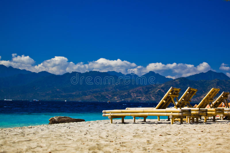 Chaise-longue at the beach stock image