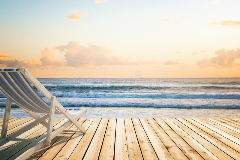 Chaise longue wooden floor seaside royalty free stock images