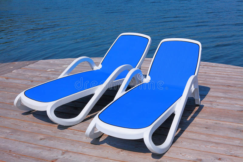Download Chaise Longues On The Deck Pier Stock Photo - Image: 9890270
