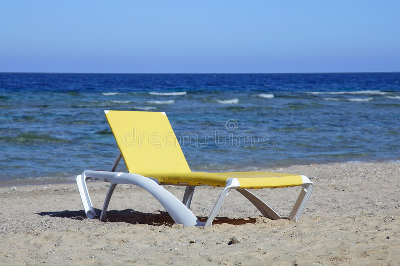 Chaise lounge on beach.