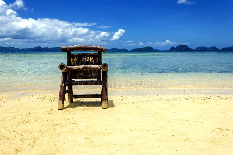 Chaise lounge on an exotic beach on a hot sunny day against the blue sea and sky stock images