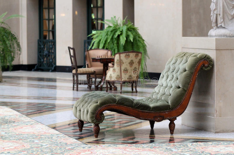 Chaise Lounge. In Hotel Lobby stock images