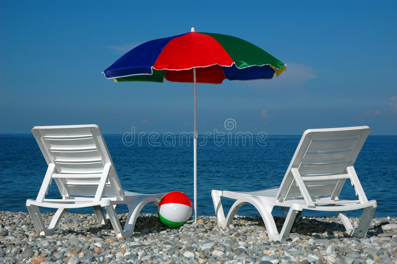 Chaise lounges and umbrella on a beach stock images for Beach chaise longue