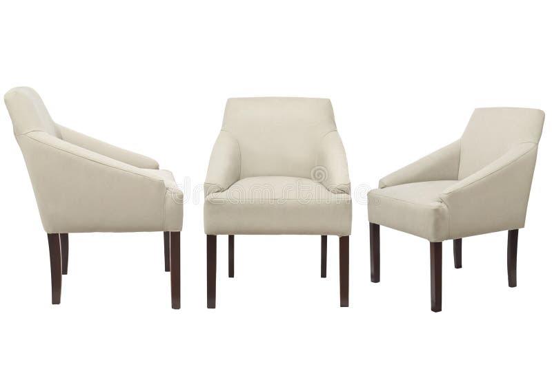 Chaises colorées sur un fond blanc image stock