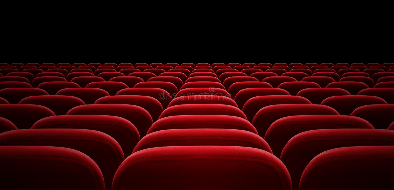 Chaises rouges de bras d'amphithéâtre ou de hall de cinéma image stock