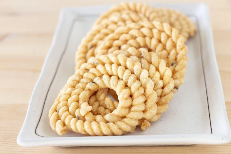 Chakli or Murukku popular vegetarian snack South India. Spiral shaped crisp deep-fried snack. Close up.. Selective focus. stock images