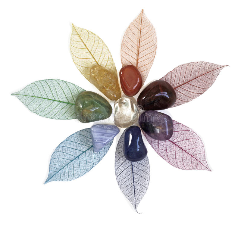 Chakra crystals on leaves stock photos