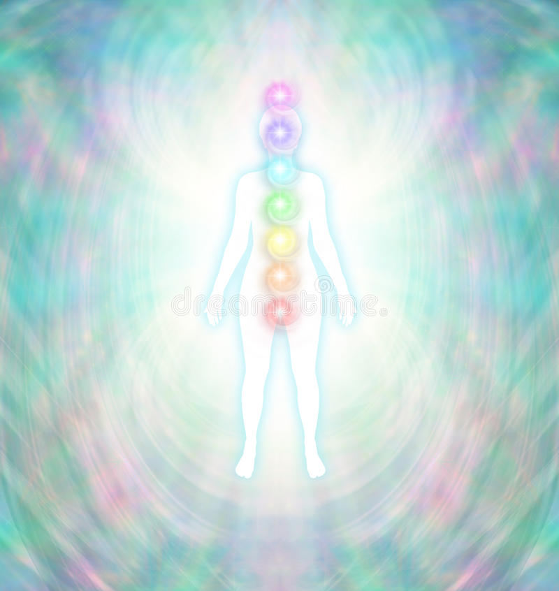 Chakra Energy Balancing. Soft pastel colored energy field around a white female silhouette with a turquoise glow, with seven chakras aligned centrally from crown stock illustration