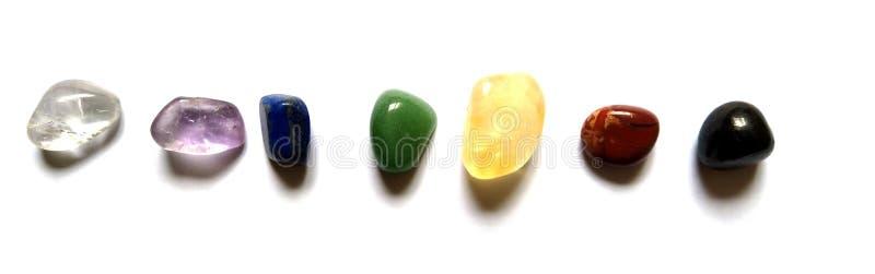 Chakra System Crystals 7 Healing Points  Sunghite, Carnelian, Citrine, Green Aventurine, Lapis Lazuli, Amethyst,  Angel Aura QUart. The 7 chakras in the body are stock image