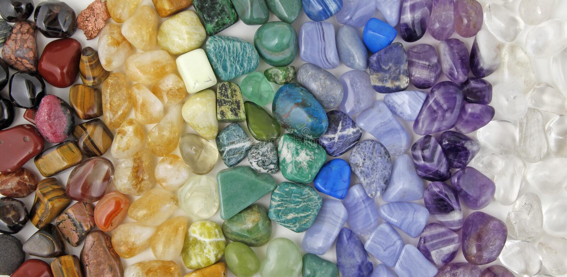 Chakra tumbled healing stones crsytal healing background stock image